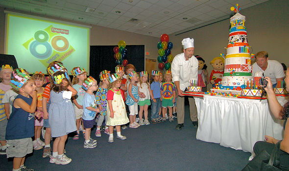 Children sing Happy 80th Birthday to Fisher-Price