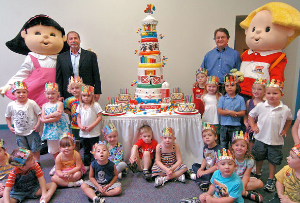 Fisher-Price executives and children celebrate company's 80th