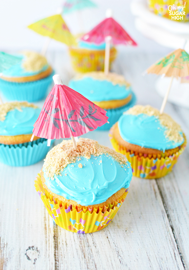 Wow guests and save time with these beach birthday cupcakes decorated with water, sand and colorful umbrellas! These easy cupcakes are perfect for your next birthday party or summer celebration like a pool party, cookout or picnic. #cupcakes #beach #kidparties #birthdayparties #summer #dessert