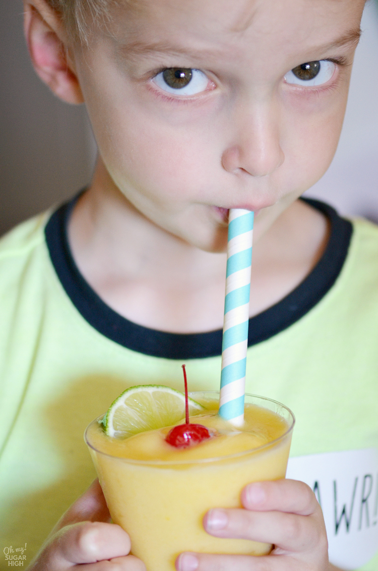 Cool off with this blended mocktail. This tropical non alcoholic summer drink is perfect for all ages and includes mango, pineapple and coconut. Serve it at your next celebration including pool parties and summer cookouts.