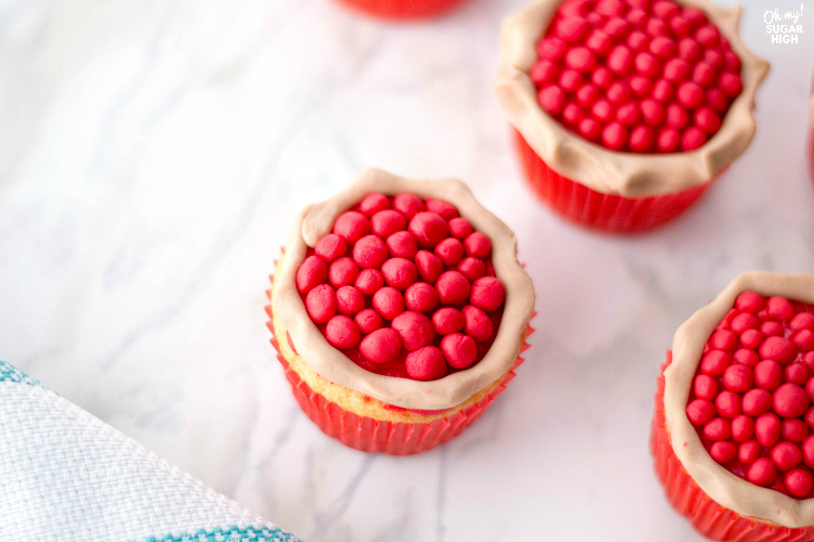These cherry pie cupcakes are a show stopper at any summer cookout or Thanksgiving dessert table. Wow the crowd with these fun vanilla cupcakes that look like they have a cherry pie sitting on top! With just a few necessary ingredients, you'll be surprised how easy these cherry cupcakes are to make for any celebration.