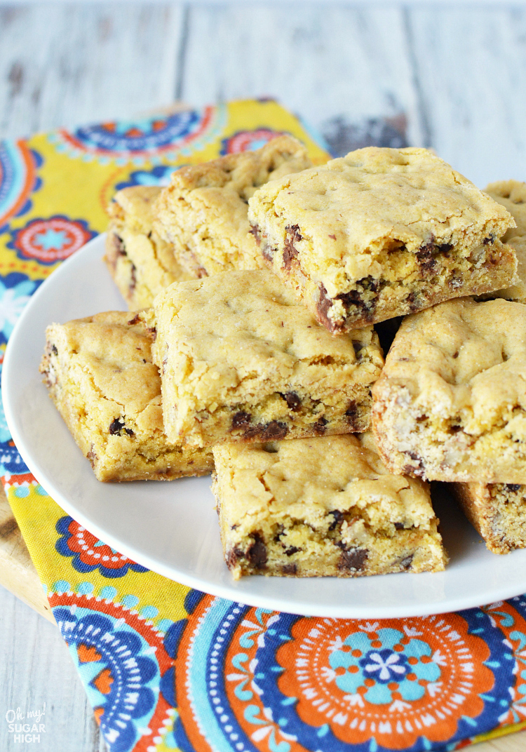If you love soft cookies you'll love these chocolate chip cookie bars! These cookie bars made from a cake mix are dense, chewy and oh so delicious. You won't regret giving them a try!
