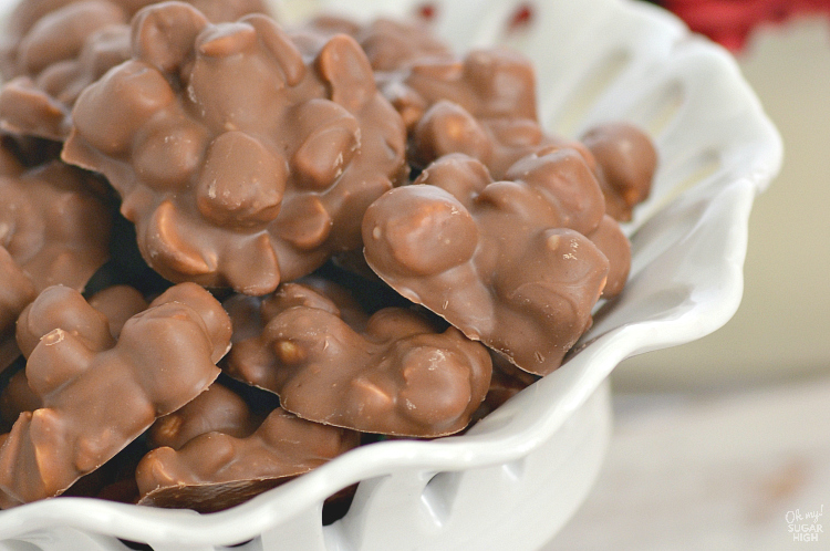 When you are short on time these chocolate peanut clusters will save the day! Loaded with peanuts and marshmallows, these homemade chocolate candies are quick and easy to prepare for a crowd. They make a perfect addition to your holiday baking!
