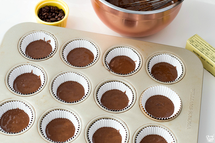 Adding chocolate coffee batter to baking tin.