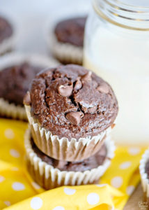 Double chocolate banana muffins stacked