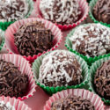 Chocolate rum balls are the perfect holiday indulgance! Made from graham cracker crumbs, this no make dessert is a great addition to your holiday gathering and easy to transport. Give this decadent confection a try!