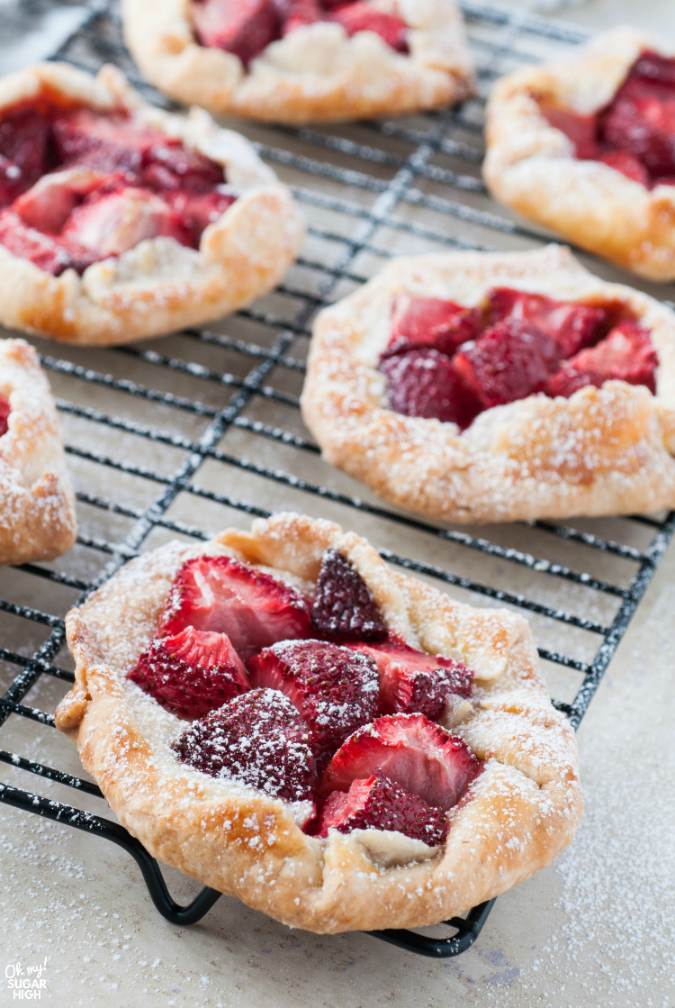 Mini Strawberry galettes on a rack with powdered sugar