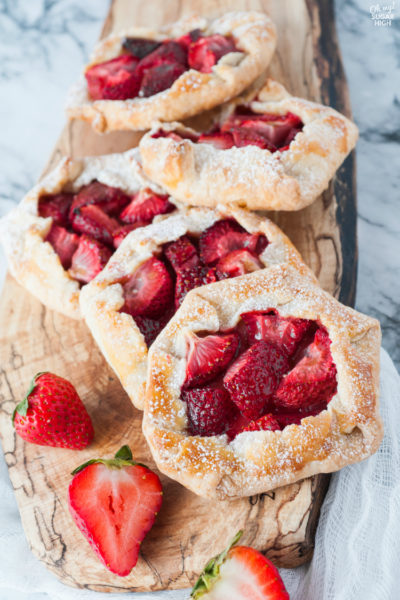 Strawberry Galette is a delicious spring or summer dessert that is easier to make than you might think! Featuring fresh strawberries and a homemade flaky crust, your family will love these mini strawberry pies!