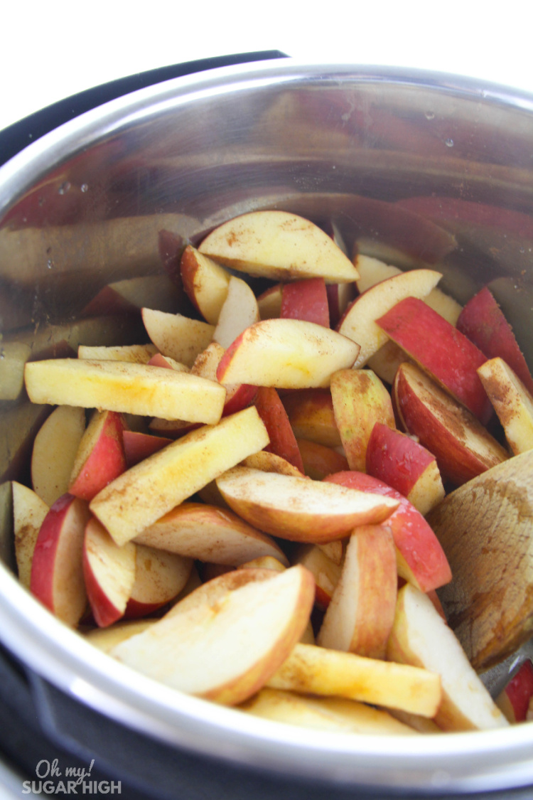 Sliced apples in the instant pot to make applesauce. Tossed with brown sugar, cinnamon, salt and lemon juice