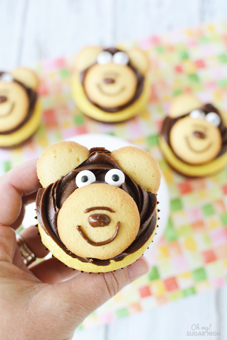 Bear Cupcake Toppers are so easy to make yourself with these step-by-step instructions. Using vanilla wafers, edible eyes and frosting, these cupcakes are super simple but work so well for multiple birthday party themes. Serve them up for your woodland, zoo, lumberjack, camping or teddy bear picnic birthday party!